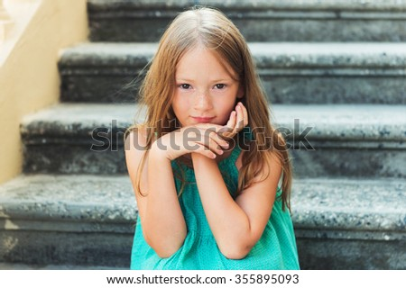Close up portrait of a cute little girl of 7-8 years old - stock photo