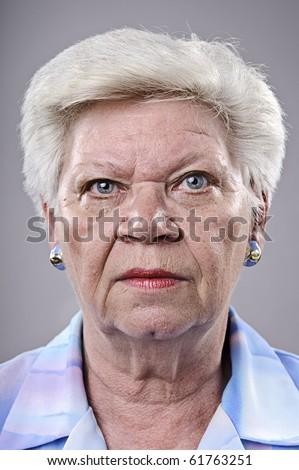 Close up portrait of a elderly woman - stock photo