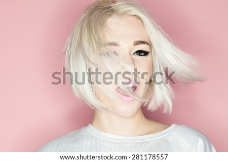 Close-up portrait of a fashion blonde with stylish short hairstyle - stock photo