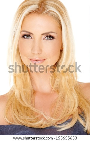 Close up portrait of a gorgeous young blond lady with long straight hair looking at the camera with a gentle smile  isolated on white - stock photo