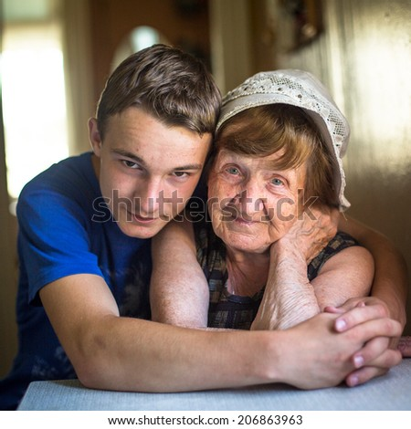 Close-up portrait of a grandmother and grandson. - stock photo