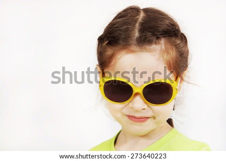 Close up portrait of a grinning cute little girl - stock photo