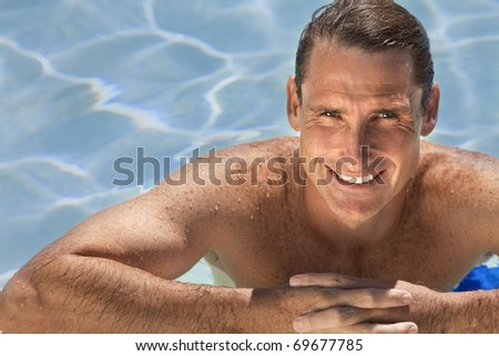 Close up portrait of a handsome and happy mid aged man relaxing resting on his hands at the side of a sun bathed swimming pool smiling with perfect teeth. - stock photo
