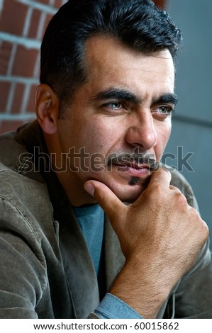 Close-up portrait of a handsome man looking away - stock photo
