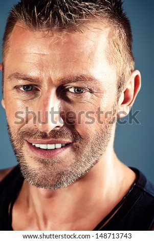 Close-up portrait of a handsome mature man. - stock photo