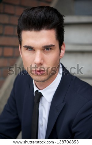 Close up portrait of a handsome young businessman - stock photo