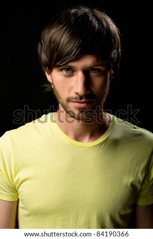 Close-up portrait of a handsome young man - stock photo