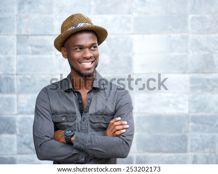 Close up portrait of a happy african american guy smiling with arms crossed - stock photo