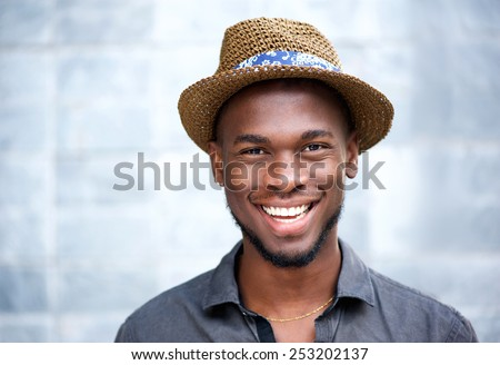 Close up portrait of a happy african american man laughing - stock photo