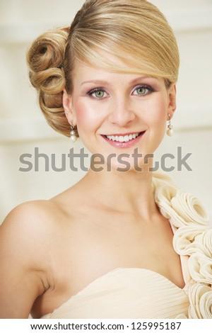 Close up portrait of a happy bride smiling - stock photo