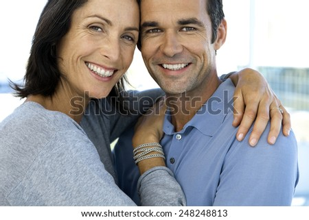 Close up portrait of a happy couple - woman and man in their forties - stock photo