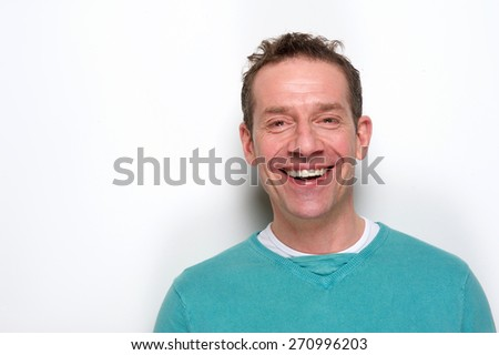 Close up portrait of a happy mid adult man laughing on white background - stock photo