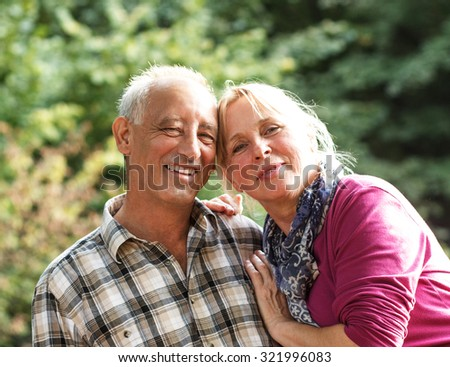 Close up portrait of a happy older couple smiling and showing affection - stock photo
