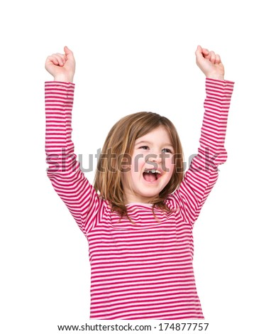 Close up portrait of a happy young girl laughing with arms raised on isolated white background - stock photo