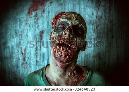 Close-up portrait of a horrible scary zombie man. Horror. Halloween.  - stock photo
