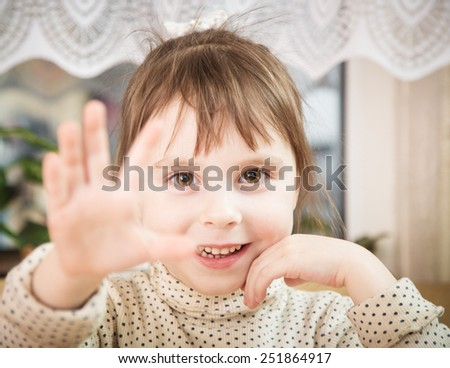 Close-up portrait of a little girl in the room. - stock photo