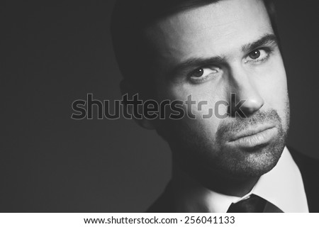 Close-up portrait of a man in black and white - stock photo