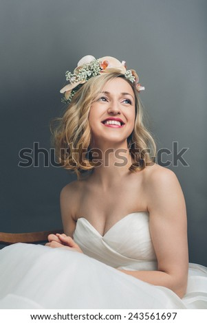 Close up portrait of a pretty blond bride smiling with happiness - stock photo