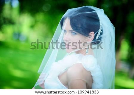 close-up portrait of a pretty shy bride - stock photo