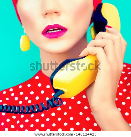 close-up portrait of a retro girl with telephone - stock photo