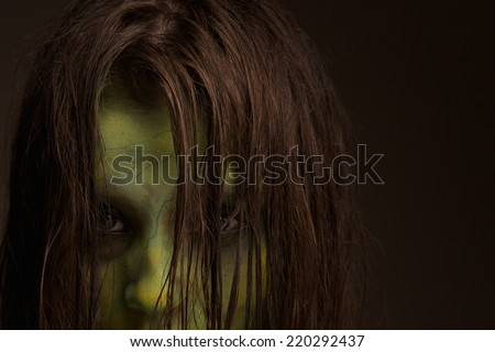 Close up portrait of a scary zombie face - stock photo