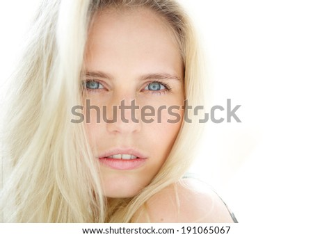 Close up portrait of a sensual young blond woman with blue eyes - stock photo