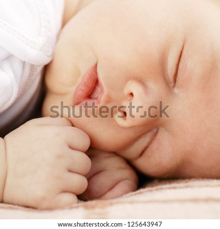 close-up portrait of a sleeping baby on white - stock photo