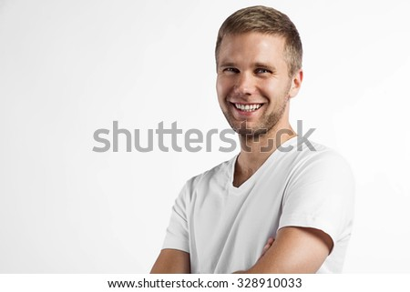 Close-up portrait of a smiling a beautiful man - stock photo