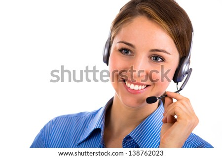 Close-up portrait of a smiling adorable customer representative talking on a phone - stock photo