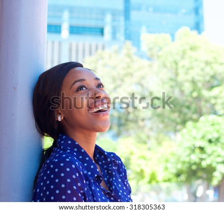 Close up portrait of a smiling african american business woman - stock photo