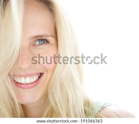 Close up portrait of a smiling blond woman  - stock photo