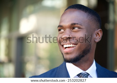 Close up portrait of a smiling business man in the city - stock photo