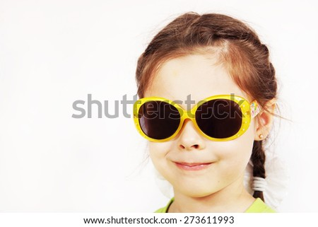 Close up portrait of a smiling cute little girl - stock photo