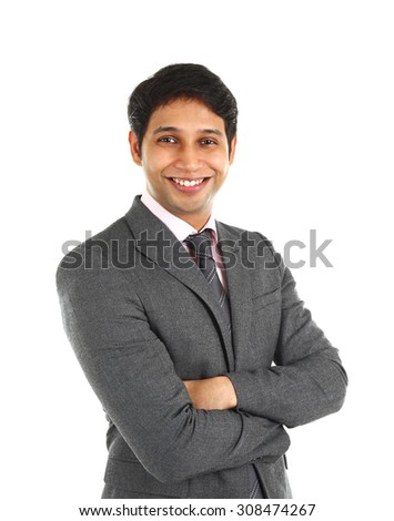 Close up portrait of a smiling Indian business man with arms crossed isolated on white. - stock photo