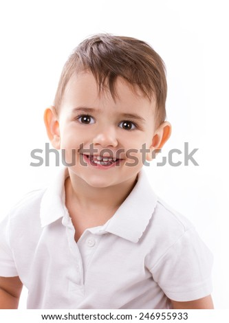 close-up portrait of a smiling little boy in white shirt on white background - stock photo