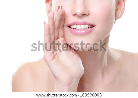 Close up portrait of a smiling skin care woman whispers (tells) a gossip. Isolated on white background - stock photo