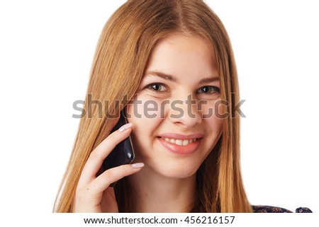 Close up portrait of a smiling woman with mobile. - stock photo