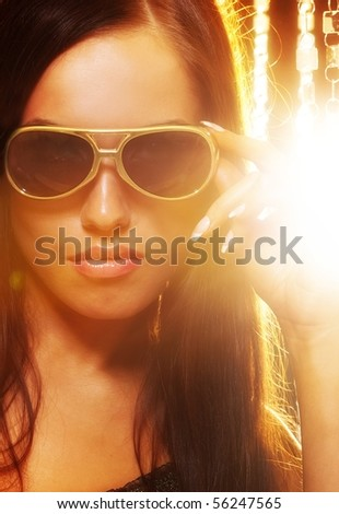 Close-up portrait of a stylish woman in sunglasses - stock photo