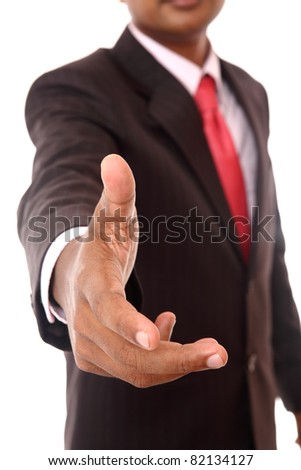 Close-up portrait of a successful business man, gesturing a hand shake - stock photo