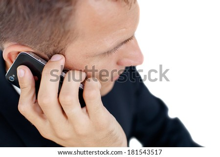 Close-up portrait of a successful handsome business man talking on cell phone, isolated on the white background. - stock photo