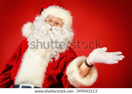 Close-up portrait of a traditional Santa Claus over red background. Copy space. Studio shot. Christmas. - stock photo