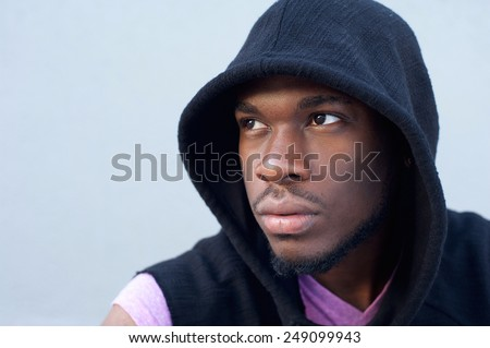 Close up portrait of a trendy young african american man with hooded sweatshirt - stock photo
