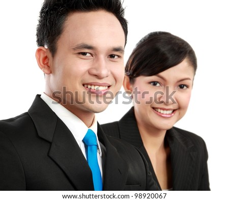 close up Portrait of a woman and man office worker smiling looking at the camera - stock photo