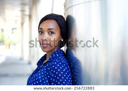 Close up portrait of a young african america business woman in blue shirt - stock photo