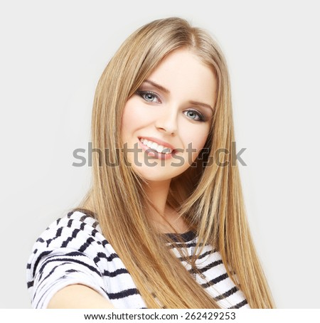 Close up portrait of a young attractive teen girl holding a smartphone digital camera with her hands and taking a selfie self portrait - stock photo