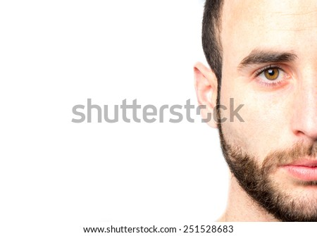 Close up portrait of a young beard man - stock photo