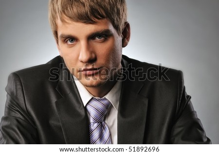 Close-up portrait of a young businessman - stock photo