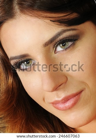 close up portrait of a Young caucasian girl with perfect clean skin and bright evening make up - stock photo