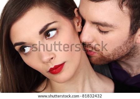 close up portrait of a young couple - stock photo