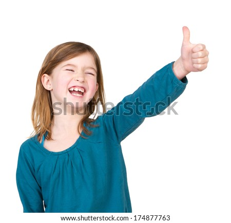 Close up portrait of a young girl laughing with thumbs up on isolated white background - stock photo